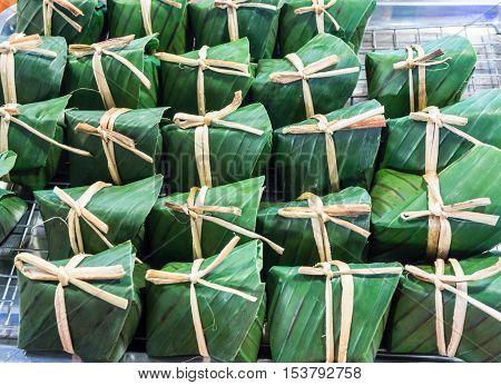 Thai dessert - Sticky rice custard wrapped in banana leaves.