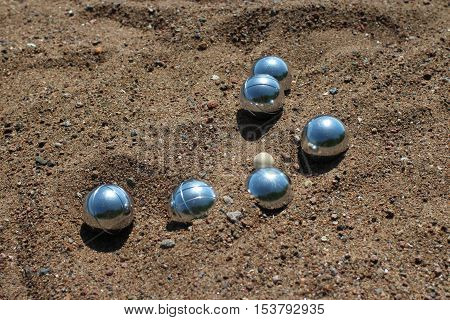 the Petanque balls on sandy close to
