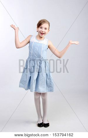 Children, people concept - the portrait of surprised young little girl over light background. Little girl surprised.