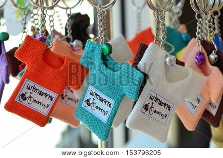 Colorful small T-shirt keychain with bell from Thailand