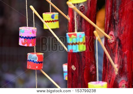 Childhood colorful toy hanging with stick and thread