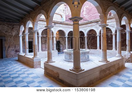 MONASTERY OF SCALA DEI, SPAIN - SEPTEMBER 17. Cloister of the Carthusian monastery Scala Dei, the Cartoixa d Escaladei, is one of the most important historic sites of Priorat on September 17, 2016