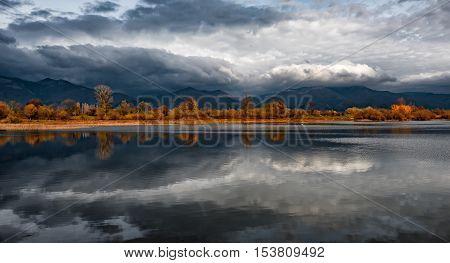 Daily autumn reflections at Koprinka Dam, Bulgaria