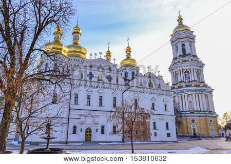 Dormition Cathedral of Kiev Pechersk Lavra Monastery and Great Lavra Bell Tower in winter. Ukrainian baroque