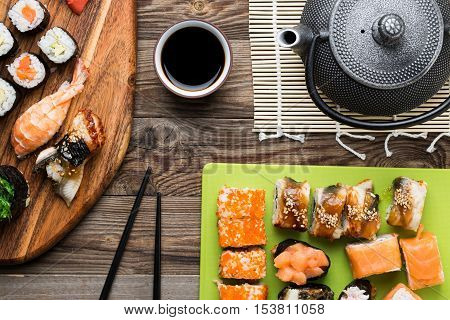 Sushi rolls with different fish and avocado, set of mouth watering delicacies, top view