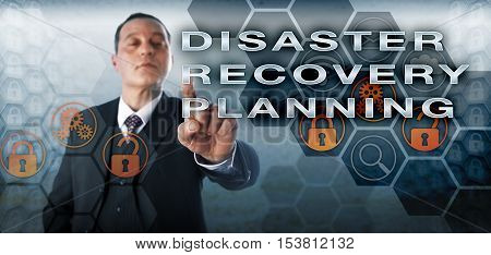 Confident manager pushing DISASTER RECOVERY PLANNING onscreen. Business challenge metaphor and information technology concept involving risk assessment and protection of critical IT infrastructure.