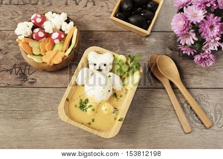 Creative Idea For Kids Lunch Or Dinner. Children Animal Food. Bath With Rice Bear And Cream Soup. Mu