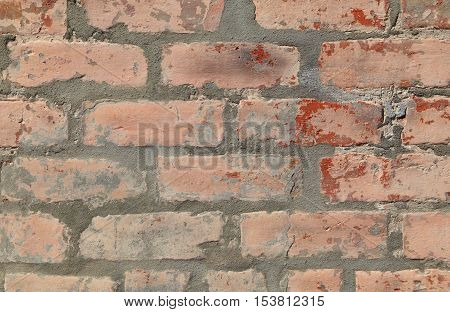 Painted brick wall forms a pattern that can be used for backgrounds.