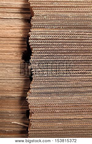 Stack of cardboard sheets in the warehouse.