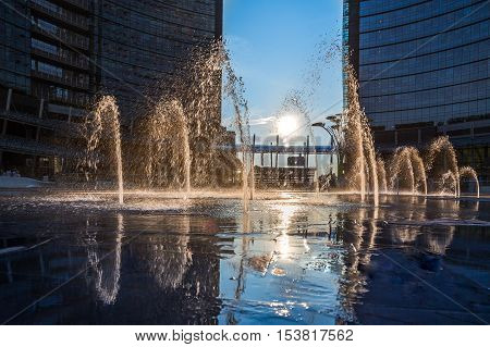Milan Porta Garibaldi district. Piazza Gae Aulenti.Sunset scene,in the foreground the fountain.