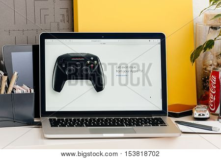 PARIS FRANCE - OCT 28 2016: Apple Computers website on new MacBook Pro Retina with OLED touch bar in a geek creative room showcasing new professional laptop - Get more from your Apple TV joystick for playing games