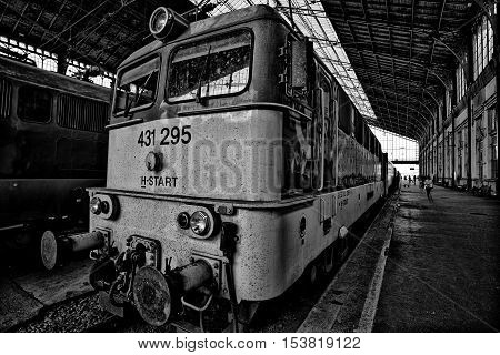 Front of a classic train in a railway station