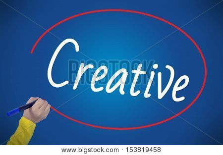 Woman hand writing create creative with marker on blue background professionally