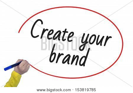 Woman hand writing create your brand with marker on white background professionally