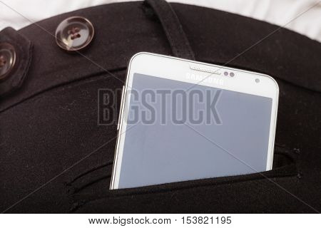 GDANSK POLAND - DECEMBER 4 2014: Samsung Galaxy Note 3 N9005 in pocket on December 4 2014 Poland. Samsung Group is a S. Korean multinational company and biggest competitor with Apples iphone.