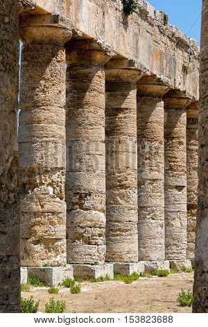 Unusually well preserved Greek Doric temple of Segesta is thought to have been built in the 420's BC by an Athenian architect and has six by fourteen columns on a base measuring 21 by 56 meters.