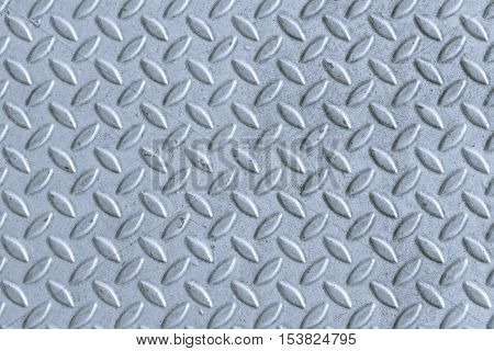 Industrial shiny metal silver list with rhombus shapes, Seamless metal texture, Table of steel sheet.