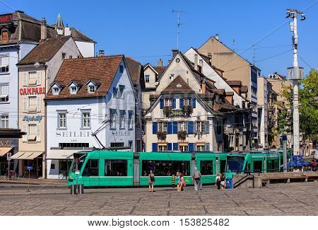 Basel, Switzerland - 27 August, 2016: buildings, people and trams on Barfuesserplatz square. Basel is a city on the Rhine river in northwestern Switzerland, situated where the Swiss, German and French borders meet.