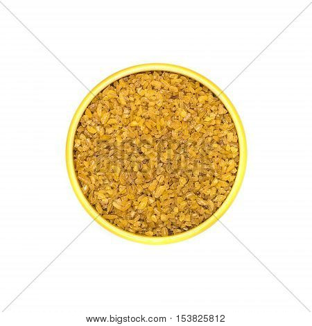 Kitchen cereal wheat groats in bowl on white background