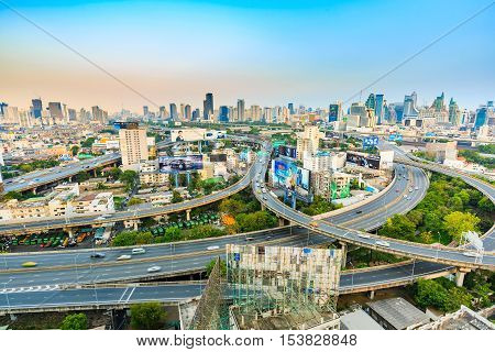 BANGKOK THAILAND - 16 APRIL 2016 - Wide angle scene of Bangkok elevated expressway and high-rise buildings in the evening light.