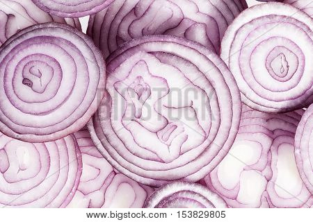 Background of red onion slices close up.