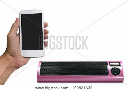 Hand holding smart phone with bluetooth speaker isolated on white background.
