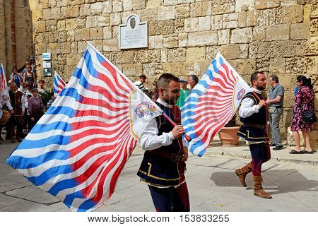 MDINA MALTA - APRIL 19: The Mdina medieval festival and tourists on April 19 2015 in Mdina Malta. More then 16 mln tourists is expected to visit Malta in year 2015.
