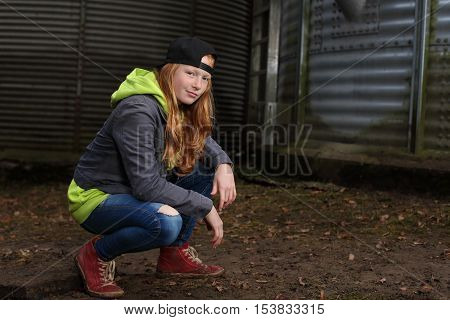 Portrait of a cool teenage girl outdoors with baseball cap