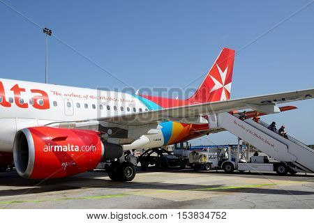LUQA MALTA - APRIL 18: The aircraft of Malta Airlines taking maintenance at Malta Airport on April 18 2015 in Luqa Malta. More then 16 mln tourists is expected to visit Malta in year 2015.
