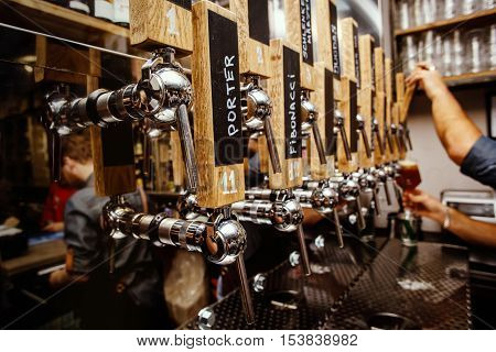 a lot of craft beer cranes in bar, authentic pub