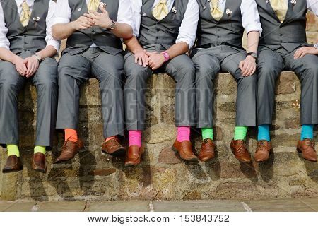 Funny colorful socks of groomsmen on summer day