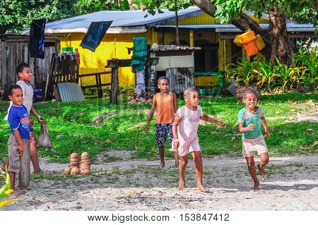 MANA ISLAND, FIJI - AUGUST 20, 2012: Kids playing together in a local village in Mana Island Fiji