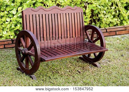 Old Wood bench on green grass background