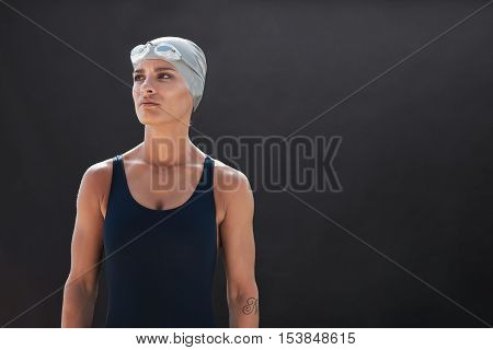 Fit Young Female Swimmer Looking Away