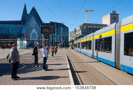 LEIPZIG, GERMANY-MARCH 12, 2014: Modern street of Leipzig with tram people and modern houses.