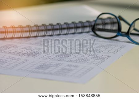 blurred of school timetable for students and teacher in thai school with note and glasses