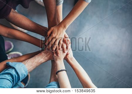 Stack Of Hands Showing Unity And Teamwork