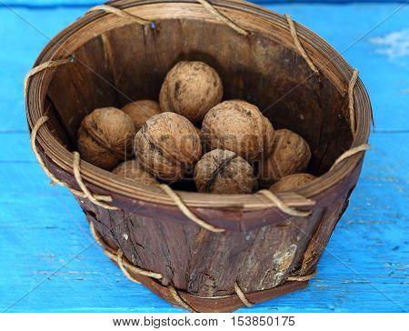 walnuts in basket shallow dept of field