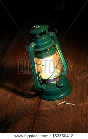 a retro kerosene lamp in the dark