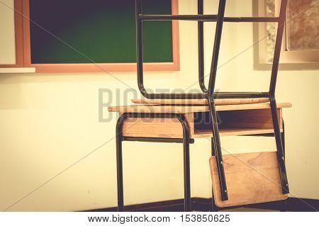 School classroom with desks wood chalkboard and whiteboard in high school vintage stlye