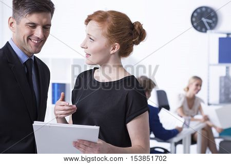 Women With Documents Talking To Her Boss