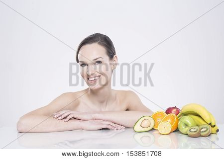Woman Sitting With Fruits
