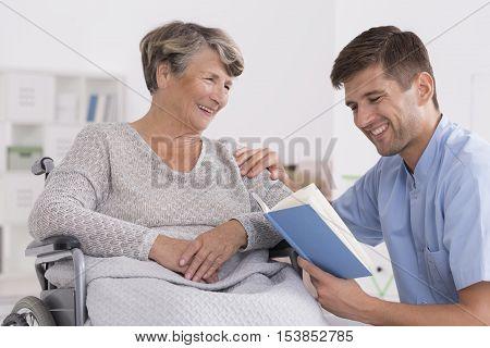 Smiled Senior Woman On Wheelchair