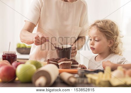 Young Boy Looking At  Muffins