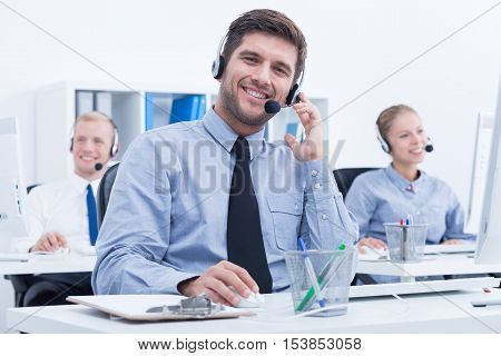 Businessman weraing headset working in customer service department