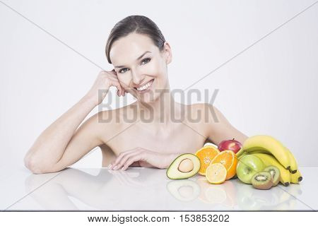 Woman Sitting With Exotic Fruits