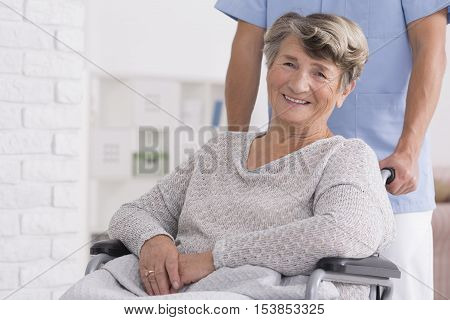 Smiled Senior Woman With Her Caregiver