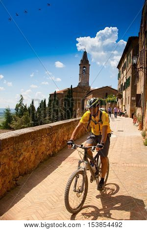 Val d'Orcia Siena mountain bike excursion in the Tuscan hills - Casello Street in Pienza