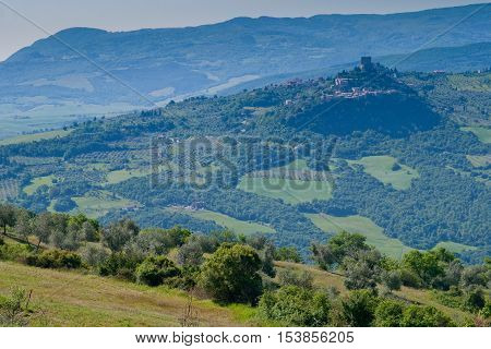 Val d'Orcia Siena mountain bike excursion in the Tuscan hills - View of Rocca d'Orcia to Bagno Vignoni