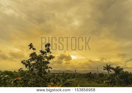 abstract sunset behind cloud on countryside - can use to display or montage on product